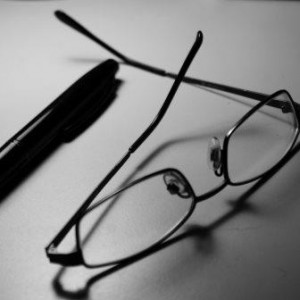 Upland Consulting - Board of Directors - Black and white pen and glasses on table