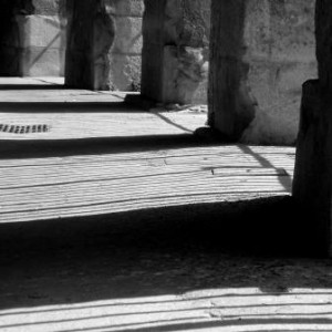 Upland Consulting: head heart and bottom line - black & white image of columns and shadows