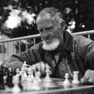 Black and white - man playing chess - Upland Consulting