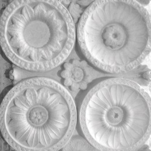 Black and white photo of carved stone ceiling rosettes from Cluny, France