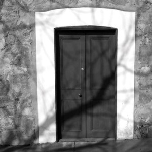 Upland Consulting Board Diversity - Black & White Photo of Locked Door in Stone Wall